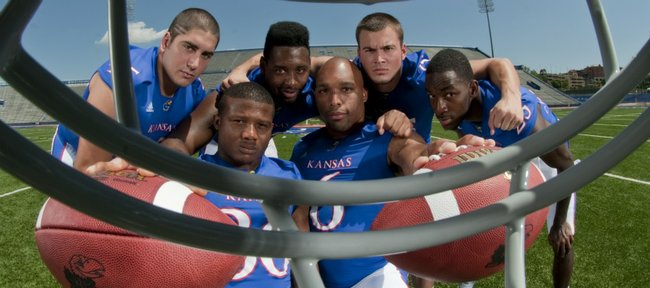 Kansas football coach Turner Gill had made stockpiling running backs a priority. The result? A group that includes, back row from left, Nick Sizemore, James Sims, Brandon Bourbon and Tony Pierson; and front row Deshaun Sands, left, and Rell Lewis.