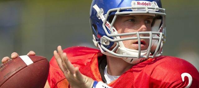 Kansas quarterback Jordan Webb looks to throw during practice on Tuesday, Aug. 23, 2011.