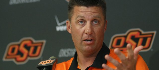 Oklahoma State head coach Mike Gundy gestures as he answers a question during a news conference in Stillwater, Okla., Thursday, Aug. 25, 2011. No. 9 Oklahoma State has matched its highest preseason ranking heading into a season filled with expectations with Brandon Weeden, Justin Blackmon and other key players back from a team that shared the Big 12 South title last season.