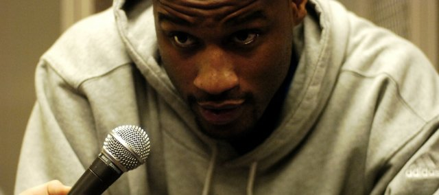 Kansas forward Darnell Jackson leans in to the microphone as he takes questions in the locker room Friday, March 21, 2008 at the Qwest Center in Omaha, Nebraska.