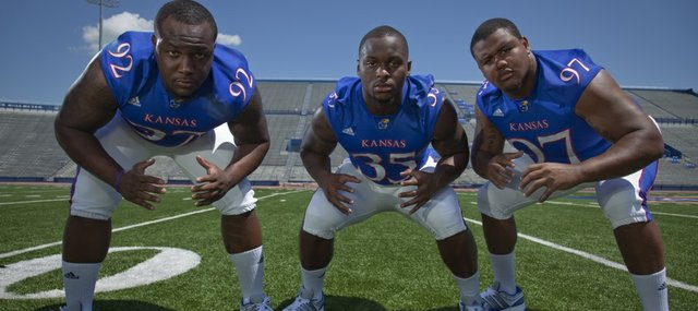 Kansas University defensive linemen, from left, Patrick Dorsey, Toben Opurum and Richard Johnson made it a priority over the offseason to work on their quickness. Dorsey will miss six to eight weeks with a broken foot, so Opurum and Johnson will be relied upon to carry the defensive line early in the season.