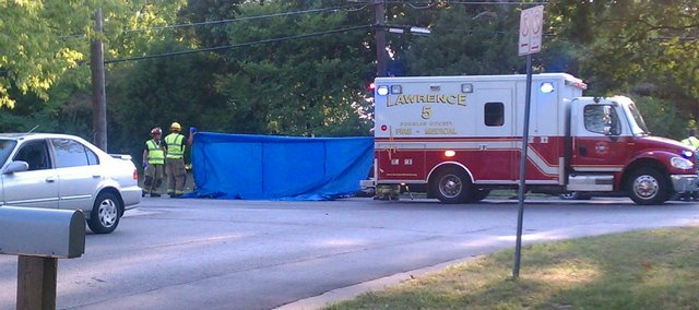 Lawrence police and medics respond to a wreck reportedly involving a motorcycle and a car near Iowa Street and University Drive on Wednesday, August 31, 2011.