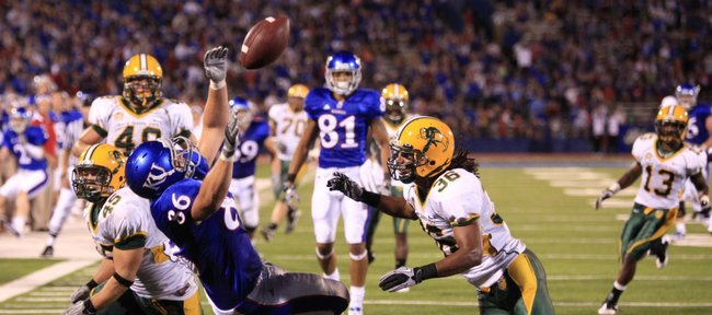 Kansas University tight end Tim Biere (86) attempts to make a catch as he's covered by North Dakota State defenders Chad Wilson (45) and Cyrus Lemon in this Sept. 4, 2010 file photo at Memorial Stadium. The Jayhawks lost the infamous game, 6-3, in their season opener last season. The stunning defeat is still fresh on the minds of many current KU players.
