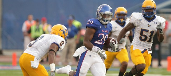 Kansas running back James Sims cuts through a hole as he heads up the field for a big gain against McNeese State during the first quarter on Saturday, Sept. 3, 2011 at Kivisto
