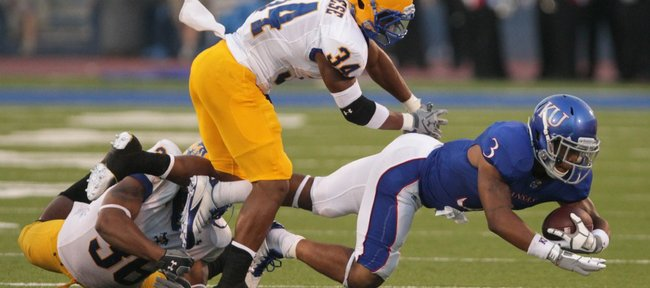 McNeese State safeties Malcolm Bronson (34) and Ryan Bronson bring down Kansas running back Darrian Miller during the second quarter on Saturday, Sept. 3, 2011 at Kivisto Field.