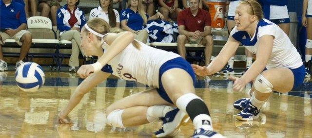KU players Caroline Jarmoc (9) and Morgan Boub scramble after the ball against South Dakota State University in the Jayhawk Invitational on Saturday, Sept. 3, 2011 at the Horejsi Center.