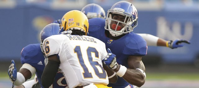 Kansas linebacker Tunde Bakare, right, comes in to tackle McNeese State receiver Darius Carey along with KU cornerback Isiah Barfield during the first quarter on Saturday, Sept. 3, 2011 at Kivisto Field.