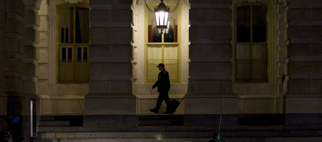 A Capitol Hill police officer walks the grounds outside of the Capitol building on Thursday, Sept. 8, 2011, in Washington.