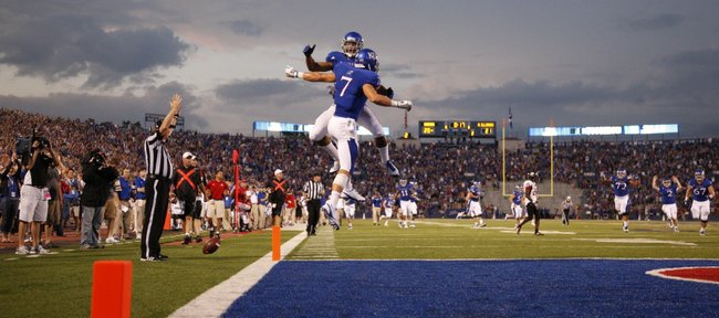 Kansas receivers Kale Pick (7) and D.J Beshears get airborne in the endzone to celebrate a touchdown by Pick late in the second quarter against Northern Illinois on Saturday, Sept. 10, 2011 at Kivisto Field.