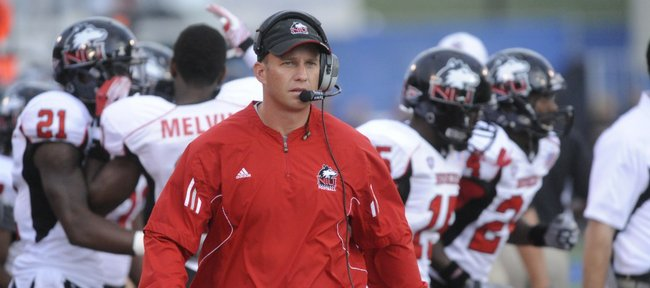 Northern Illinois coach Dave Doeren walks the sideline in the second quarter Saturday, Sept. 10, 2011 at Memorial Stadium.