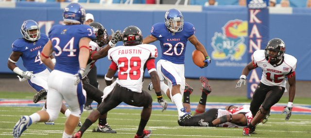 Kansas kick returner D.J. Beshears (20) hops a defender as he cruises up-field against Northern Illinois during the first quarter on Saturday, Sept. 10, 2011 at Memorial Stadium. Beshears was named the Big 12 Special Teams Player of the Week Monday, the second time he has received the honor.