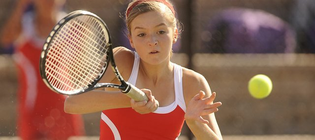 Lawrence High freshman Chloe Clement hits a return Monday, Sept. 12, 2011.