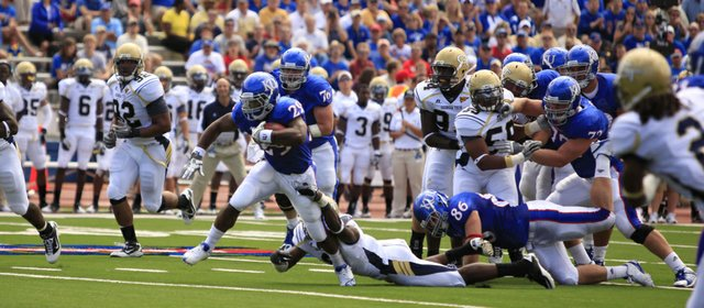 Kansas freshman running back James Sims takes off on a run against the Georgia Tech defense during the first quarter, Saturday, Sept. 11, 2010 at Kivisto Field.
