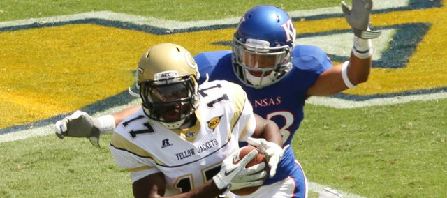 Kansas defender Tyler Patmon comes in to tackle Georgia Tech's Orwin Smith in the first half Saturday, Sept. 17, 2011 in Atlanta.
