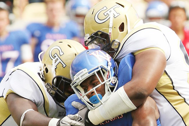 Kansas running back Tony Pierson is gobbled up by the Georgia Tech defense Saturday, Sept. 17, 2011 in Atlanta.