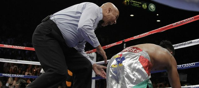 Referee Joe Cortez yells at Victor Ortiz after he was knocked down by Floyd Mayweather Jr. during their WBC welterweight title fight on Saturday, Sept. 17, 2011, in Las Vegas.