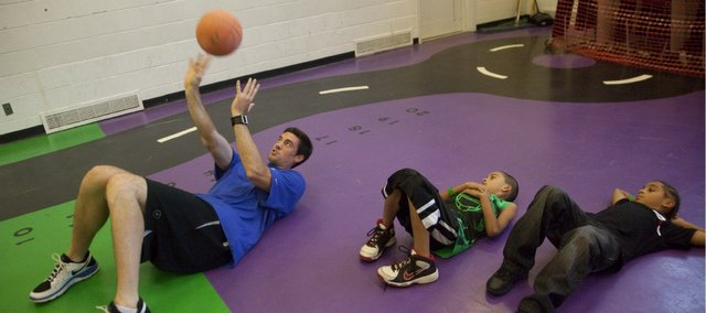 Former Kansas University basketball player and current member of the Oklahoma City Thunder Nick Collison helps tip off FitClub34, which encourages physical fitness among youth. He was in Lawrence at the Boys and Girls Club of East Heights on Tuesday, Sept. 20, 2011.