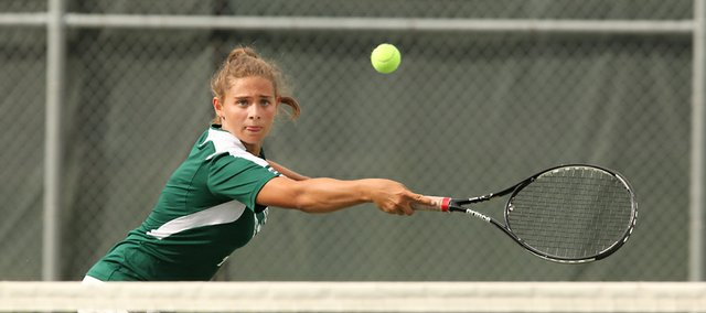 Free State&#39;s Emily Sadoski reaches out for return on Wednesday September 21, 2011.
