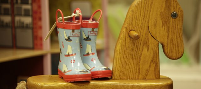 Galoshes, which are fashionable for adults are also penetrating the market for children's footwear. Fit and durability are key in getting the right shoes for your children.