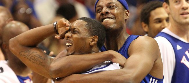 Paul Pierce jokes with Mario Chalmers after Chalmers hit the Legends of the Phog scrimmage's game-tying shot at the buzzer Saturday, Sept. 24, 2011 at Allen Fieldhouse.