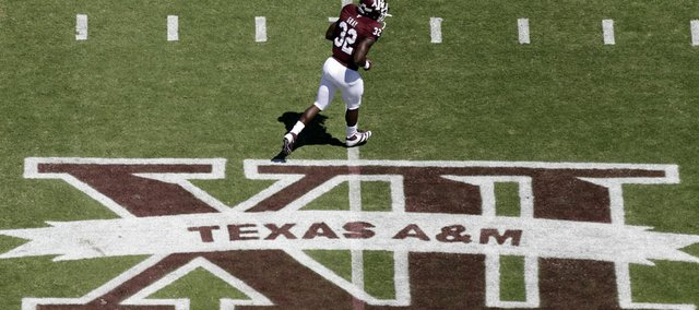 In this photo taken Saturday, Sept. 24, 2011, Texas A&M running back Cyrus Gray (32) runs across the field before taking on Oklahoma State in College Station, Texas.