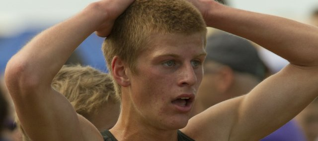 Lawrence High's Gavin Fischer catches his breath just after crossing the finish line of the boys 5K run in the Rim Rock Classic on Saturday, Sept. 24, 2011 at Rim Rock Farm.