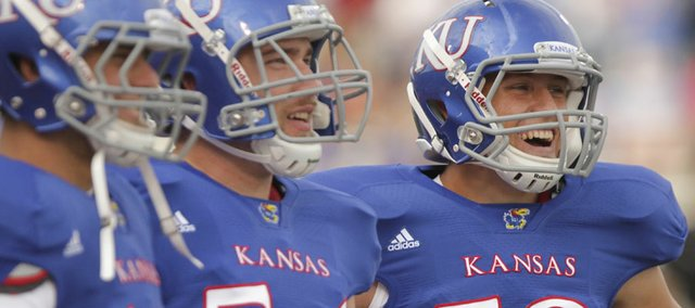 Kansas long snapper Tanner Gibas, far right (59), laughs with teammate Justin Carnes (54) and punter Victor McBride prior to kickoff against Northern Illinois in this file photo from Sept. 10, 2011.