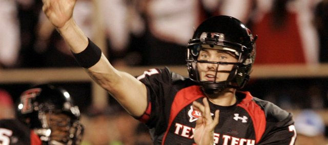 Texas Tech quarterback Seth Doege attempts a pass against Texas A&M in this Oct. 24, 2009 file photo in Lubbock, Texas. Doege, who has thrown 11 touchdowns and zero interceptions this season, will lead the Red Raiders to Lawrence to take on Kansas University on Saturday at Memorial Stadium.