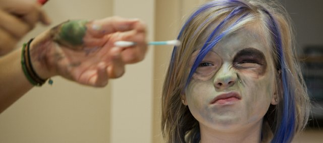"""Parvaneh Karch-Agnew, 9, was getting her """"zombie face"""" applied by makeup artist Elahe Marjovi. The fifth annual Lawrence Zombie Walk will be Thursday, Oct. 6, and benefits the Lawrence Humane Society."""