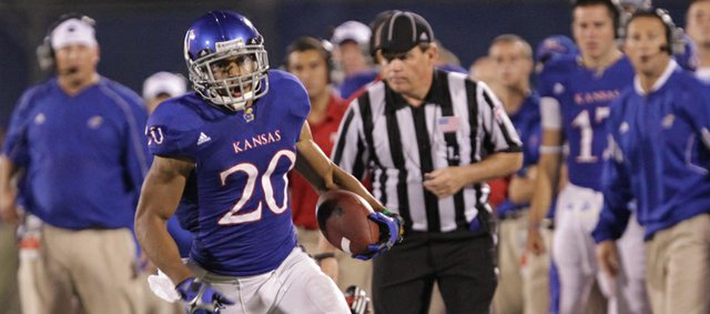 Kansas receiver D.J. Beshears leaves a Northern Illinois defender in the dust as he charges up the sideline for yardage during the Jayhawks' final drive of the fourth quarter on Saturday, Sept. 10, 2011 at Kivisto Field.