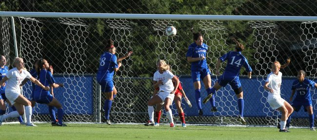 The Kansas defense works to prevent a shot on goal from Texas during a corner kick in the first half on Friday, Sept. 30, 2011.