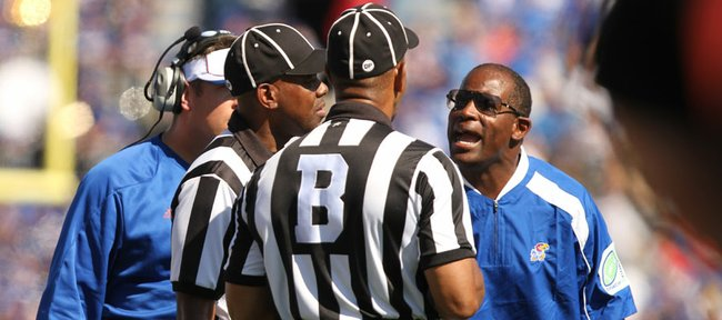 Kansas head coach Turner Gill has words for the officiating crew after a play in which tight end Tim Biere dropped a pass that was recovered for a KU touchdown during the first quarter on Saturday, Oct. 1, 2011 at Kivisto Field.