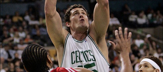 Boston's Raef LaFrentz shoots over Houston's Derek Anderson (8) during the first quarter. The Celtics won, 102-82, Sunday in Boston as LaFrentz tied his career high in points and went 7-for-9 from three-point range.