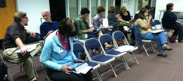 Principals were among folks in the audience for the Monday, Sept. 19, 2011 meeting of the Central and East Lawrence Elementary School Consolidation Working Group. In the front row with her head down was Nancy DeGarmo, principal of New York School, working her iPad. In the back row, to the side of Lawrence school board members Keith Diaz Moore and Rick Ingram, were Principals Cris Anderson, of Kennedy School; Jeanne Fridell, of Woodlawn School; Lesa Frantz, of Pinckney School; and Tammy Becker, of Hillcrest School. Chris Bay, principal of Sunset Hill School, didn't make the picture, as he was sitting off to the side.