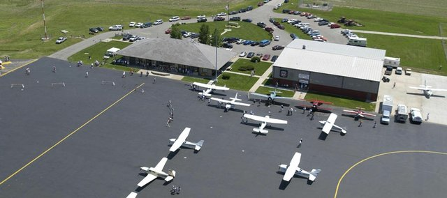 At an open house at Lawrence Municipal Airport, visitors were treated to the display of several vintage and modern aircraft  as well as the spruced up facility. Federal funds coming to Kansas are responsible for a new, longer runway at the airport.