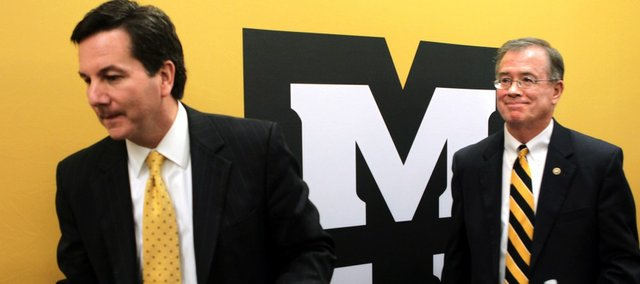 University of Missouri Interim President Steve Owens, left, and Chancellor Brady Deaton leave a news conference following a meeting of the Board of Curators, Tuesday, Oct. 4, 2011, in St. Louis. Missouri will leave the Big 12 for the SEC.