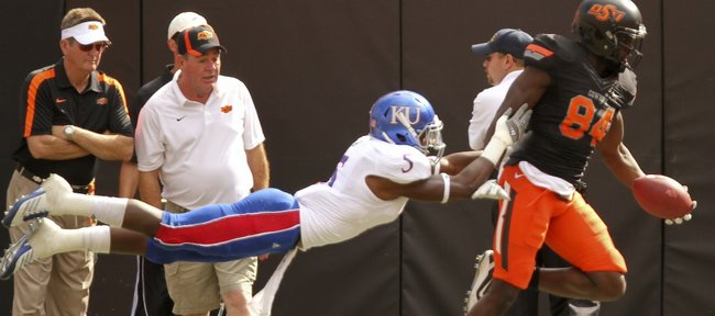 Kansas cornerback Greg Brown lays out to force Oklahoma State receiver Hubert Anyiam out of bounds after a long reception during the first quarter on Saturday, Oct. 8, 2011 at Boone Pickens Stadium.