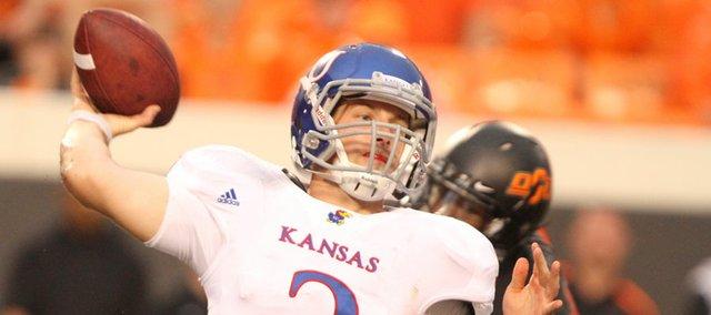 Kansas quarterback Jordan Webb throws against Oklahoma State during the fourth quarter on Saturday, Oct. 8, 2011 at Boone Pickens Stadium.