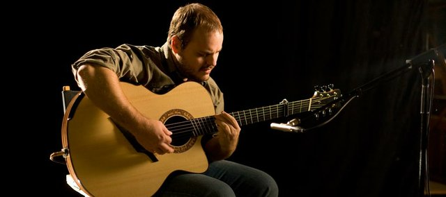 Topeka fingerstyle guitarist Andy McKee headlines the Guitar Masters tour, which stops at the Lawrence Arts Center this week.