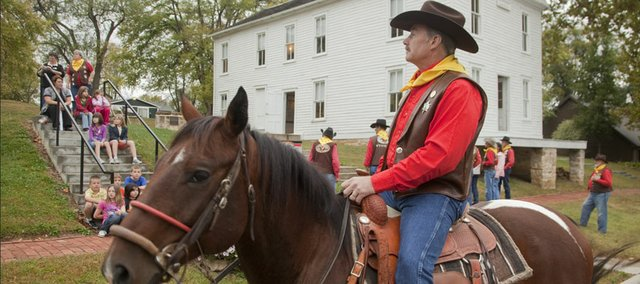 Jim Swigart, who is the national President of the National Pony Express Association, waits outside of Constitution Hall on Monday, Oct. 10, before the start of a Pony Express ride to the Kansas Statehouse in Topeka. More than a dozen riders carried a mochila — a saddle bag — of letters from former Kansas governors to the capitol to honor both the state's 150th anniversary and the 150th anniversary of the termination of the Pony Express.