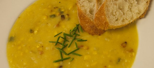 Corn chowder is one of just many types of chowder populating the winter soup landscape. Here, Wheatfields Cafe and Bakery's Roasted Corn Chowder is served with a bit of house-made bread.