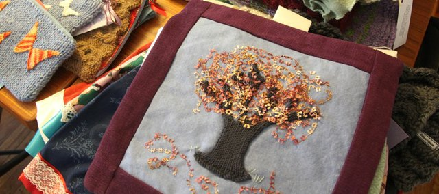 Some of Eden Detrixhe's work for her Etsy shop, Woolflower Boutique includes wall hangings, scarves, cowls and patterns for little knit Christmas trees.