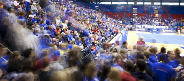 A rush of basketball fans enter Allen Fieldhouse for Late Night in the Phog on Friday, Oct. 14, 2011.