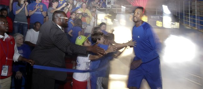 Kansas forward Thomas Robinson is introduced to the Fieldhouse crowd as he enters the court during Late Night in the Phog on Friday, Oct. 14, 2011.