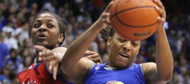 Kansas forward Aishah Sutherland pulls a rebound away from Catherine Williams during the Late Night in the Phog scrimmage on Friday, Oct. 14, 2011 at Allen Fieldhouse.