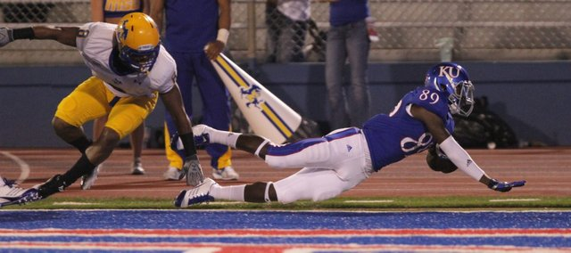 Kansas receiver JaCorey Shepherd dives past McNeese State cornerback Seth Thomas and into the endzone for a touchdown during the third quarter on Saturday, Sept. 3, 2011 at Kivisto Field.