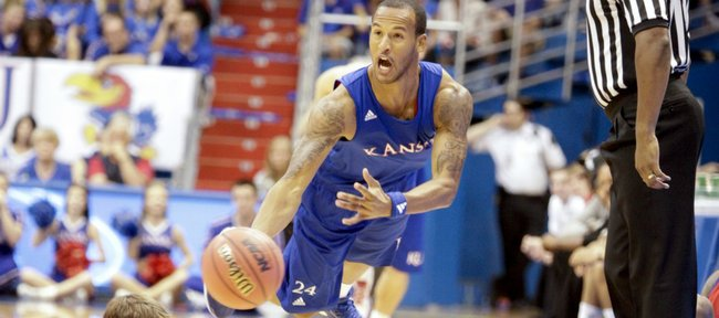 Kansas guard Travis Releford scoops a pass up the court after stealing the ball from Conner Teahan during the Late Night in the Phog scrimmage on Friday, Oct. 14, 2011 at Allen Fieldhouse.