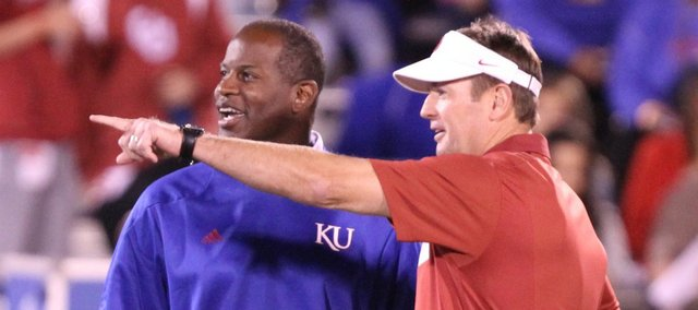 Kansas head coach Turner Gill and Oklahoma head coach Bob Stoops have a laugh prior to kickoff on Saturday, Oct. 15, 2011 at Kivisto Field.