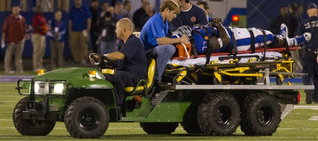 Kansas offensive lineman Jeremiah Hatch is taken off the field on a stretcher in the first half of Kansas' game against Oklahoma on Saturday, Oct. 15, 2011. Hatch returned to the Kansas sideline late in the second half.