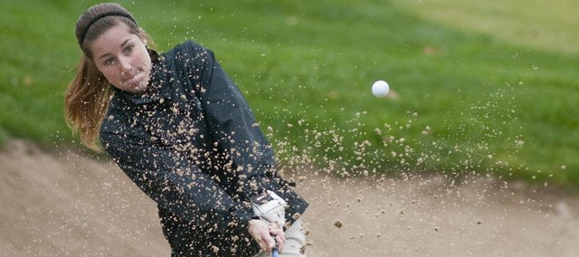 Lawrence Free State golfer Madison Brumley chips out of a sandtrap at the 18th green during the 6A girls state golf championships at Shadow Glen Country Club, in Olathe on Monday, Oct. 17, 2011.